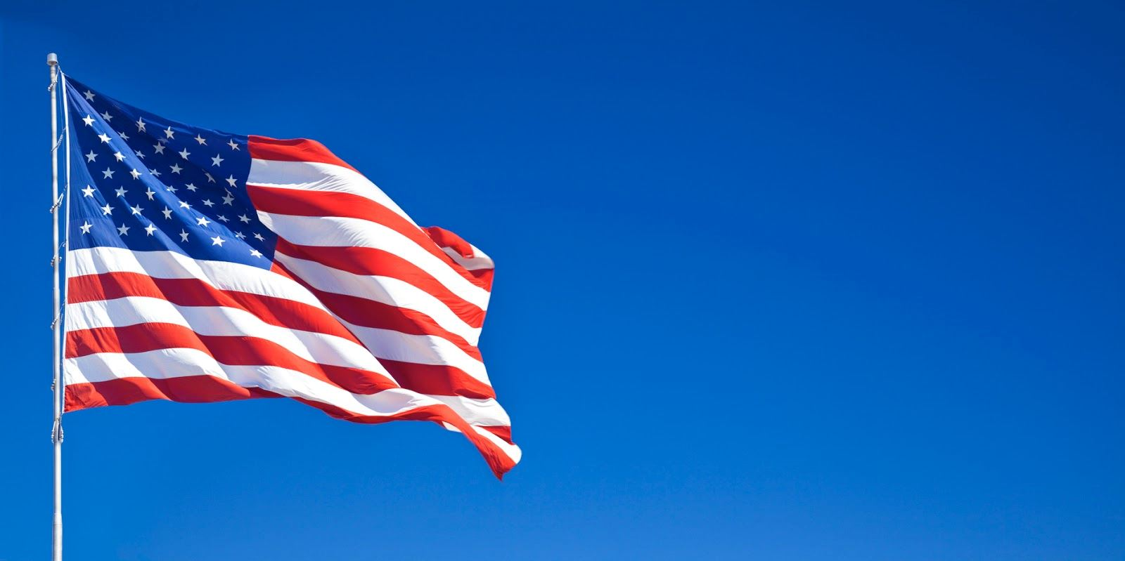 american-flag-waving-blue-sky